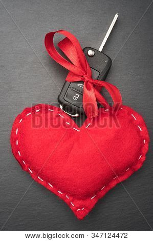 Car Key With Red Bow And A Heart.