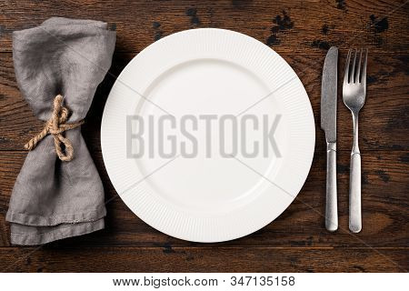 Table Setting With Empty White Plate, Cutlery And Table Napkin. Top View, Copy Space For Text. Dinne