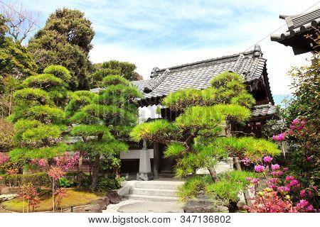 Ancient pavilion in traditional japanese ornamental garden, Hasedera temple, Kamakura, Japan