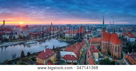Wroclaw, Poland. Panoramic Aerial Cityscape Of Old Town And Oder River On Sunset