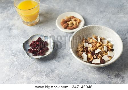 Bowl Of Granola With Nuts, Cranberry And Cocoanut. Concept For A Tasty And Healthy Meal. Stone Backg