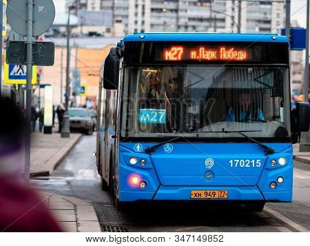 Moscow, Russia - January 17, 2020: The Blue M27 Bus Pulls Up To A Public Transport Stop. City Street
