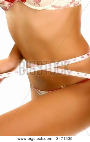Woman Measuring Her Body With A Tape