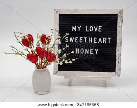 Valentine's Hearts In A Vase With Words, My Love, Sweetheart And Honey On Letter Board With White Ba