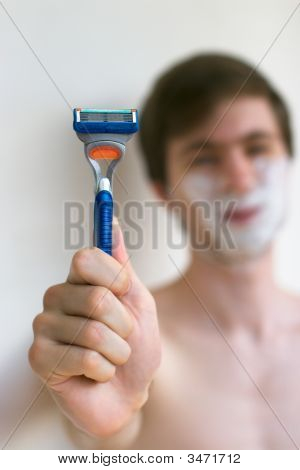 Men Holding Razor Close Up