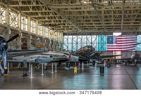 Oahu, Hawaii, Usa. - January 10, 2020: Pearl Harbor Aviation Museum. Line Of Airplanes In Hangar Wit