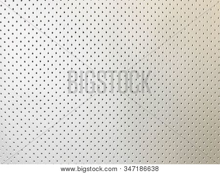 Car Seat Perforated Leather Background. Interior Detail