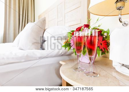 Two Glasses Of Rose Champagne In The Upscale Hotel Room. Dating, Romance, Honeymoon, Valentine, Geta