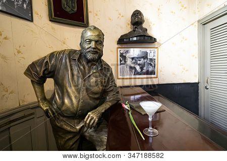 November 26, 2019, Havana, Cuba: Glass Of Daiquiri Cocktail And Statue Of American Writer Ernest Hem