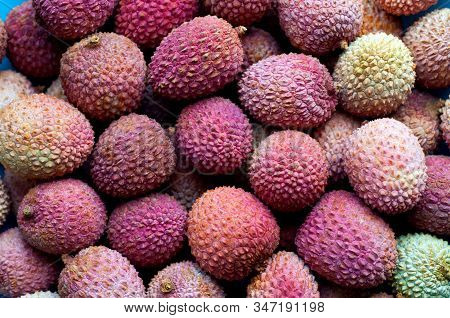 Lychee Fruit On Wooden Background. Fresh Lychee Tropical Fruit.