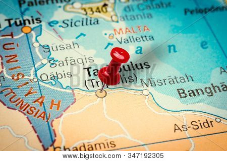 Prague, Czech Republic - January 12, 2019: Red Thumbtack In A Map. Pushpin Pointing At Tripoli City