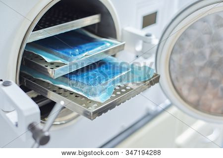 Sterilization Of Medical Dental Instruments In Autoclave, Close-up Laboratory Sterilizer In Dentistr