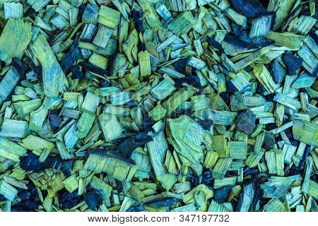 Colored In Green And Yellow Sawdust Or Shavings Background Or Texture. Heap Of Splinters, Slivers An