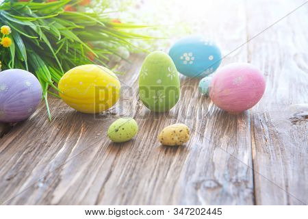 Colorful Easter Eggs And Flowers On Rustic Wooden Planks