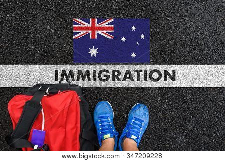 Man In Shoes With Bag Standing Next To Line With Word Immigration And Flag Of Australia On Asphalt R
