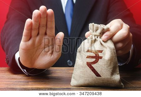 Businessman Refuses To Give Indian Rupee Money Bag. Refusal To Grant Loan Mortgage, Bad Credit Histo