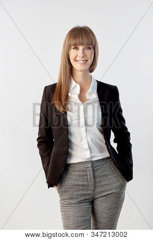 Happy white young business woman. Successful woman with happy smile, isolated on white.