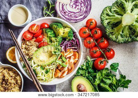 Buddha Bowl Vegan Salad With Quinoa, Avocado, Broccoli, Sweet Potato And Tahini Dressing, Gray Backg