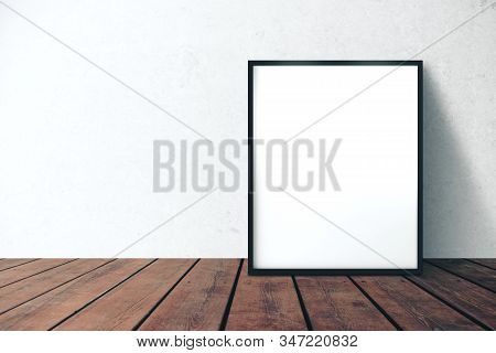 Blank Picture Frame In Interior With White Wall And Wooden Floor. Mock Up, 3d Rendering