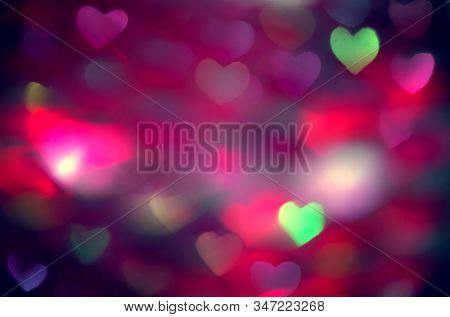 Valentine's Day Background. Holiday Blinking Abstract Valentine Backdrop with Glowing colourful Heart. Heart Shape Bokeh. Love concept