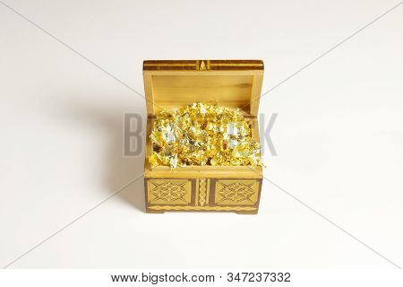 Opened Single Casket With Golden Foil As Gold Inside Isolated On White With Soft Shadows, Wooden Box