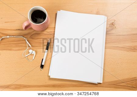Top View Of Modern Desk Office Workplace With  A4 Paper. Blank Branding Template. Photo Blank Form.