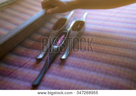 Woman Working On Weaving Machine For Weave Handmade Fabric. Textile Weaving. Weaving Using Tradition