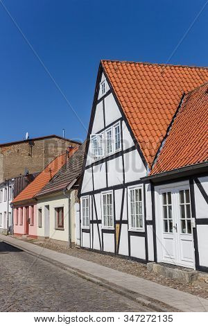 White Half Timbered House In The Old Town Of Grimmen, Germany