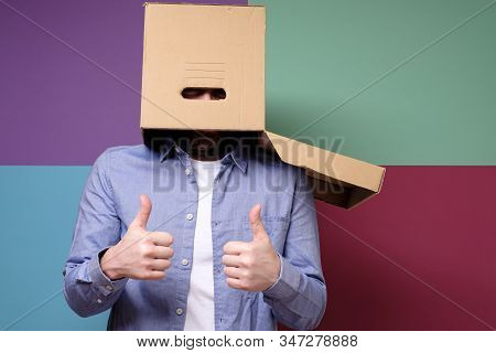 Funny, Weird Man Put A Cardboard Box On Head And Shows A Positive Gesture, Thumbs Up. Concept Of She