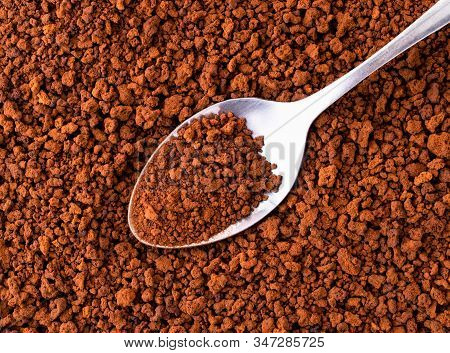 Granular Instant Coffee With A Spoon, Background. The View From The Top