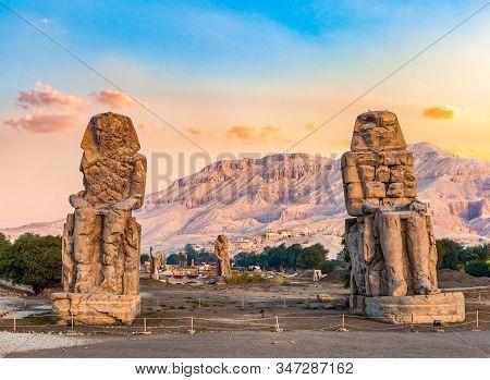 Sunrise Over Colossi Of Memnon In Luxor, Egypt
