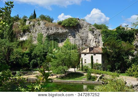 Medieval Village Fontaine De Vaucluse On The River Shore. The Poet Petrarch Made It His Preferred Re