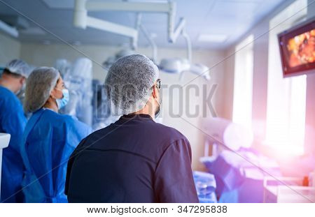 Process Of Surgery Operation Using Medical Equipment. Surgeon In Operating Room With Surgery Equipme