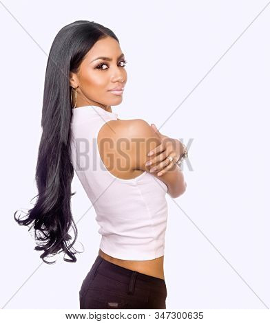 Woman with long dark hair isolated against white background