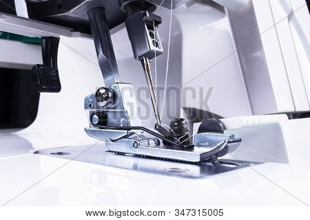 Presser Foot Of Sewing Machine With Needle And Thread Close Up. Detail Of Sewing Machine. The Sewing