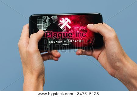 Samara, Russia -07, 29, 2019: A Young Guy Playing Plague Inc: Evolved Game On Iphone 8 Plus. Teenage