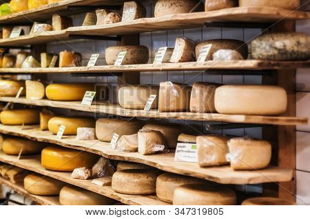 Traditional Dutch Cheese Displayed For Sale In Shop Market