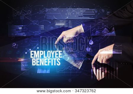 Businessman touching huge screen with EMPLOYEE BENEFITS inscription, cyber business concept