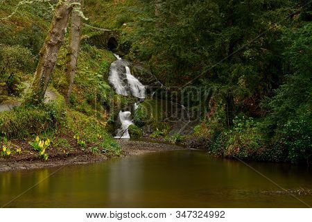 Conwy.wales.united Kingdom.march 18th 2017.long Exposure Of A Waterfall In The Woods At Bodnant Gard