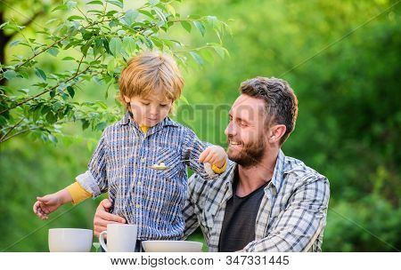 Nutrition Kids And Adults. Little Boy And Dad Eat. Everything Is More Fun With Father. Organic Nutri