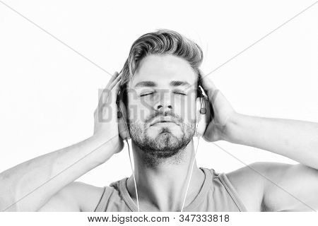 Ebook And Online Education. Music Education. Sexy Muscular Man Listen Ebook. Man In Earphones Isolat