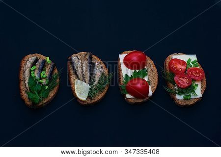 A Variety Of Sandwiches With Various Fillings On A Dark Background. Sandwiches With Sprats, With Sar