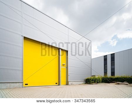 Commercial Warehouse Exterior With A Yellow Roller Door
