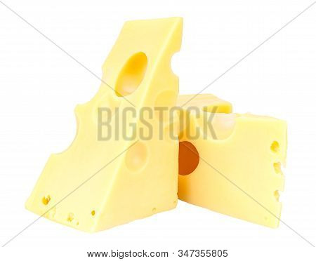 Standing And Lying Two Triangular Pieces Of Maasdam Cheese Isolated On A White Background