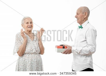 Family, Holidays, Christmas, Age And People Concept - Happy Senior Couple With Gift Box At Home, Dre