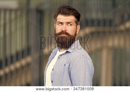 Declare Your Style. Serious Bearded Man. Handsome Brutal Man. Hair And Beard Care. Male Barber Care.