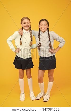 Friendship Begins With Smile. Happy Schoolgirls Enjoying Bonds Of Friendship. Little Children Celebr