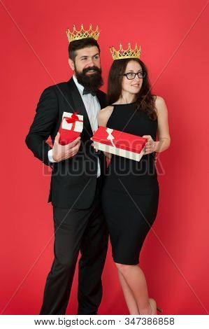Being Recognised And Proud. Proud Couple Got Presents. Sensual Woman And Bearded Man Wear Crowns. Pr