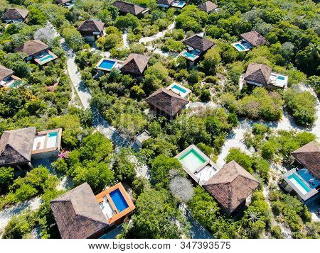Aerial View Of Luxury Villa With Swimming Pool In Tropical Forest. Private Tropical Villa With Swimm
