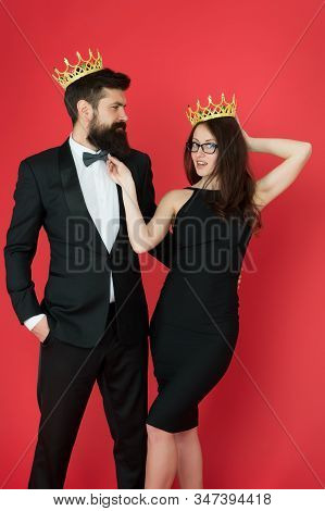 Success Is Our Goal. Happy Lovers Celebrate Success. Couple In Love Wear Crowns Red Background. Enjo